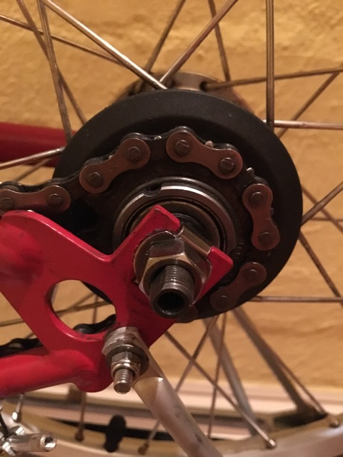 Before the chain tensioner is on, this is where the indicator chain threads into the Sturmey Archer hub on my 3 speed Brompton